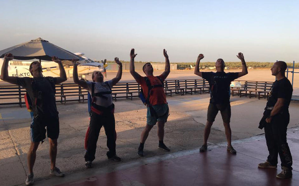 Ground school training at sunset over in Skydive Spain with Active Skydiving AFF courses.