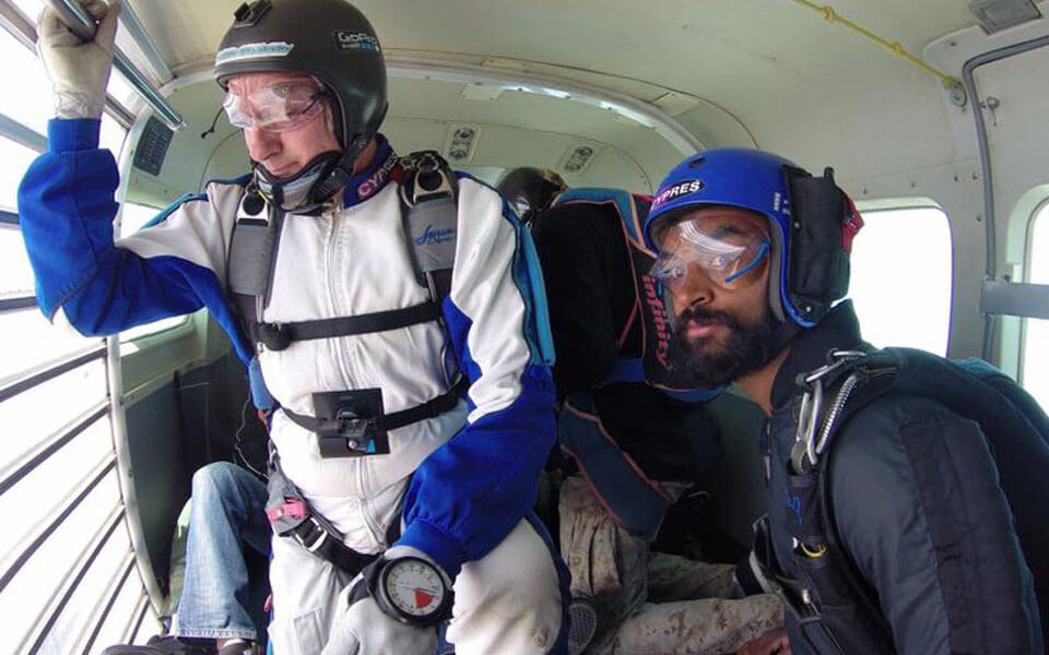 Preparing to exit the aircraft on AFF course while learning to skydive.