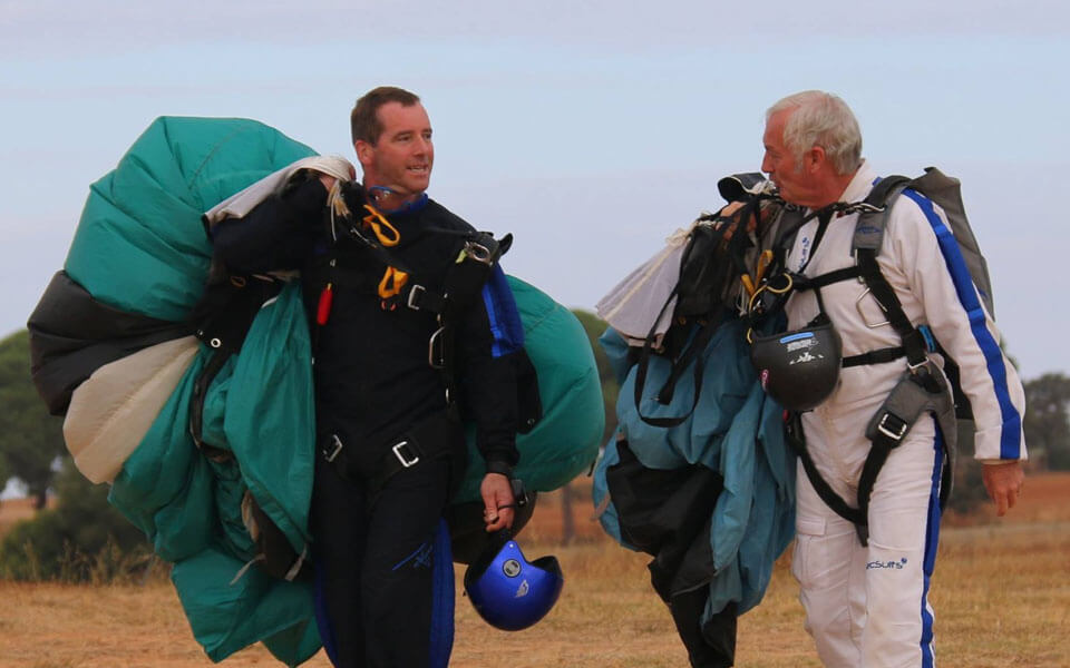 A nice photo of instructor and student after just landing their parachutes.