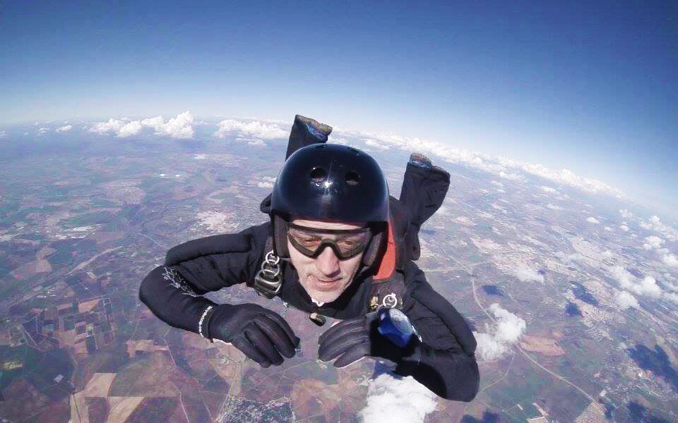 A skydive photo with a student learning to skydive on his AFF course.